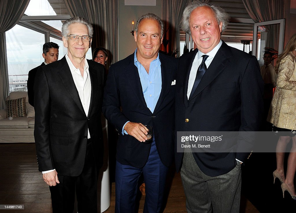 Filmmaker David Cronenberg, Charles Finch and Vanity Fair editor Graydon Carter attend the IWC and Finch's Quarterly Review Annual Filmmakers Dinner at Hotel Du Cap-Eden Roc on May 21, 2012 in Antibes, France.