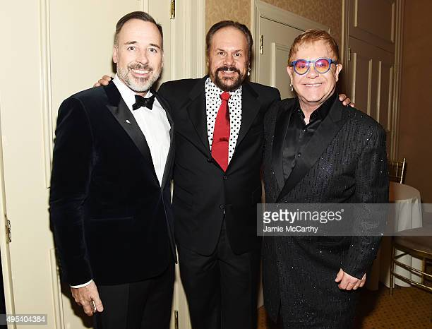 Filmmaker David Furnish musician Harry Wayne 'KC' Casey and Sir Elton John attend Elton John AIDS Foundation's 14th Annual An Enduring Vision Benefit...