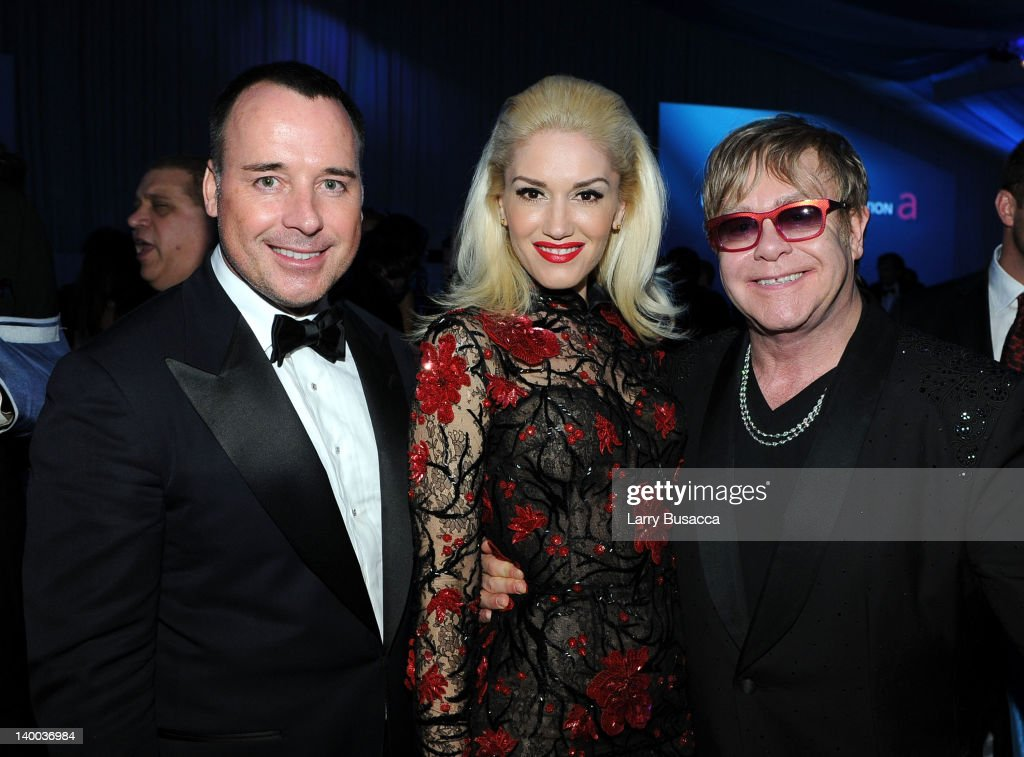 Filmmaker David Furnish, singer Gwen Stefani and Sir Elton John attend the 20th Annual Elton John AIDS Foundation Academy Awards Viewing Party at The City of West Hollywood Park on February 26, 2012 in Beverly Hills, California.