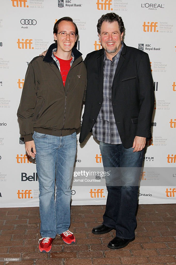Filmmaker Don (R) and Cesare Gagliardi attend the 'John Dies At The End' Premiere during the 2012 Toronto International Film Festival held at Ryerson Theatre on September 15, 2012 in Toronto, Canada.