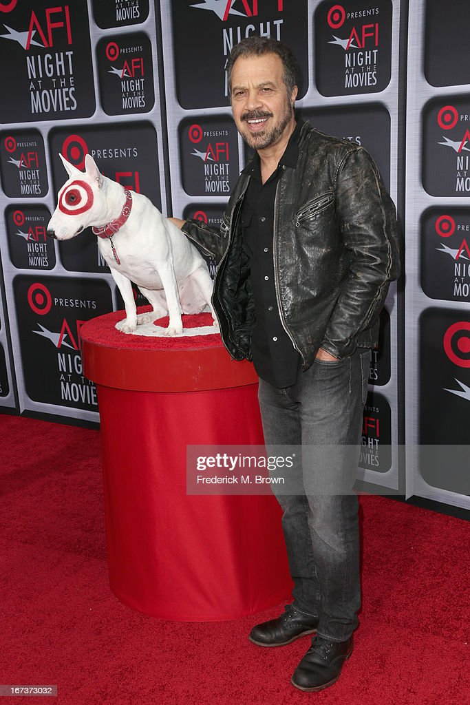 Filmmaker <a gi-track='captionPersonalityLinkClicked' href=/galleries/search?phrase=Edward+Zwick&family=editorial&specificpeople=215060 ng-click='$event.stopPropagation()'>Edward Zwick</a> (R) poses with Bullseye on the red carpet for Target Presents AFI's Night at the Movies at ArcLight Cinemas on April 24, 2013 in Hollywood, California.