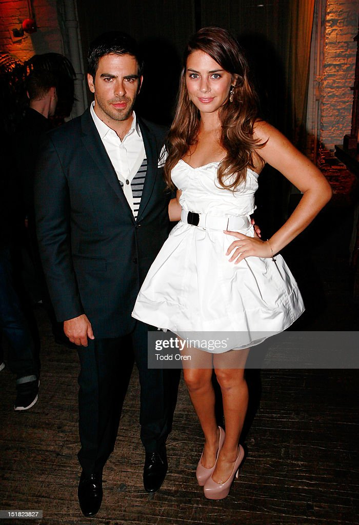 Filmmaker <a gi-track='captionPersonalityLinkClicked' href=/galleries/search?phrase=Eli+Roth&family=editorial&specificpeople=543948 ng-click='$event.stopPropagation()'>Eli Roth</a> (L) and actress Lorenza Izzo attend the Worldview Entertainment Cocktail Party and Dinner at Brassaii Restaurant and Lounge during the 2012 Toronto International Film Festival at Brassaii on September 11, 2012 in Toronto, Canada.