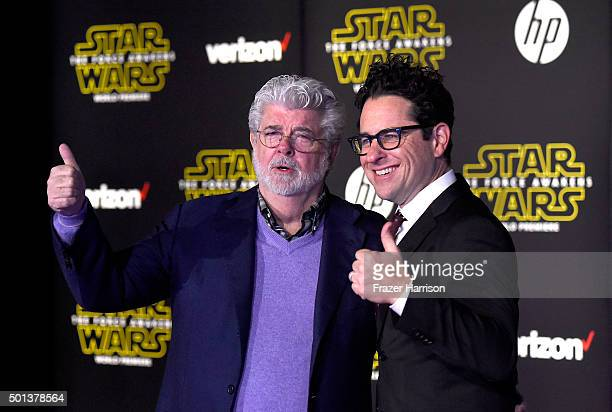 Filmmaker George Lucas and writerdirector JJ Abrams attend the Premiere of Walt Disney Pictures and Lucasfilm's 'Star Wars The Force Awakens' on...