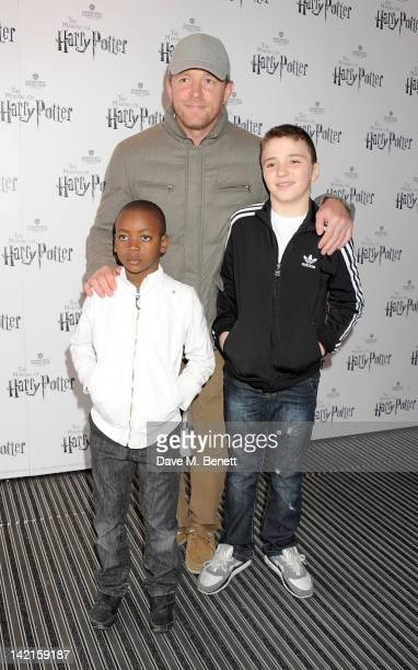Filmmaker Guy Ritchie and sons David Banda and Rocco Richie attend the Grand Opening of the Warner Bros Studio Tour London The Making of Harry Potter...
