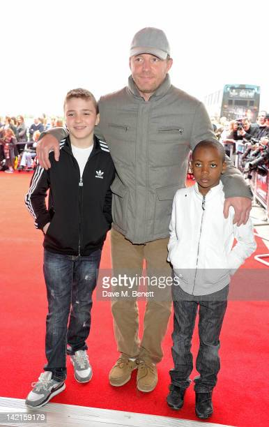 Filmmaker Guy Ritchie with sons Rocco Ritchie and David Banda attend the Grand Opening of the Warner Bros Studio Tour London The Making of Harry...