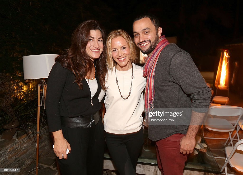 Filmmaker Jehane Noujaim, actress/activist Maria Bello and producer Karim Amer attend the screening for 'The Square' at the home of Maria Bello on October 11, 2013 in Santa Monica, California.