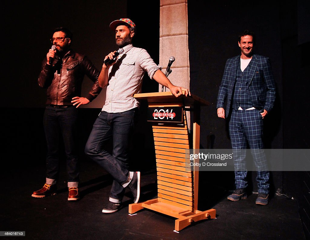 Filmmaker Jemaine Clement, filmmaker Taika Waititi and Sundance Film Festival Director of Programming Trevor Groth onstage at 'What We Do In The Shadows' premiere at the Egyptian Theatre during the 2014 Sundance Film Festival on January 19, 2014 in Park City, Utah.