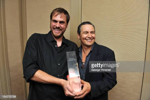 Filmmaker Jim Mickle and writer/actor Nick Damici pose with the Cadillac People�s Choice Midnight Madness Award for 'Stake Land' at the 35th Toronto...
