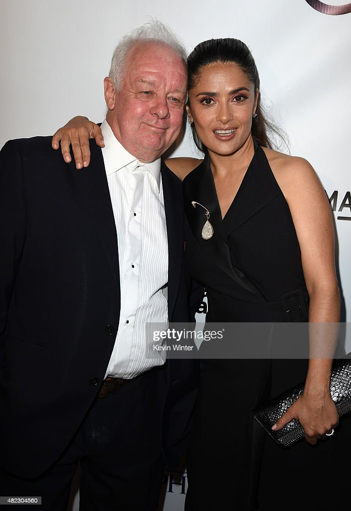 Filmmaker Jim Sheridan (L) and actress/producer Salma Hayek Pinault attend the screening of GKIDS' 'Kahlil Gibran's the Prophet' at Bing Theatre at LACMA on July 29, 2015 in Los Angeles, California.