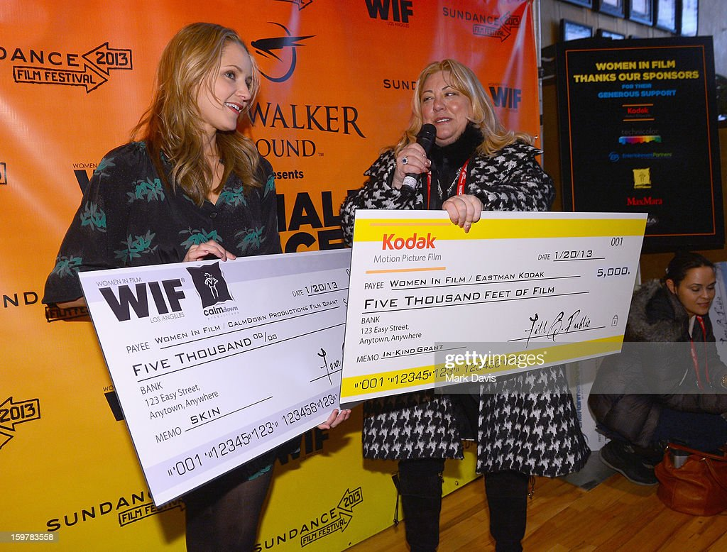 Filmmaker <a gi-track='captionPersonalityLinkClicked' href=/galleries/search?phrase=Jordana+Spiro&family=editorial&specificpeople=691872 ng-click='$event.stopPropagation()'>Jordana Spiro</a> accepts award check for Women In Film / CalmDown Productions grant from moderator Lucy Webb during the Women In Film's Sundance Filmmakers Panel presented by Skywalker Sound on January 20, 2013 in Park City, Utah.