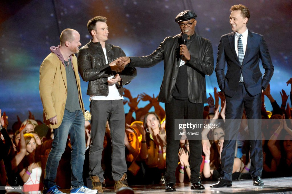 Filmmaker Joss Whedon, actor Chris Pine, actor Samuel L. Jackson and actor Tim Hiddleston speak onstage during the 2013 MTV Movie Awards at Sony Pictures Studios on April 14, 2013 in Culver City, California.