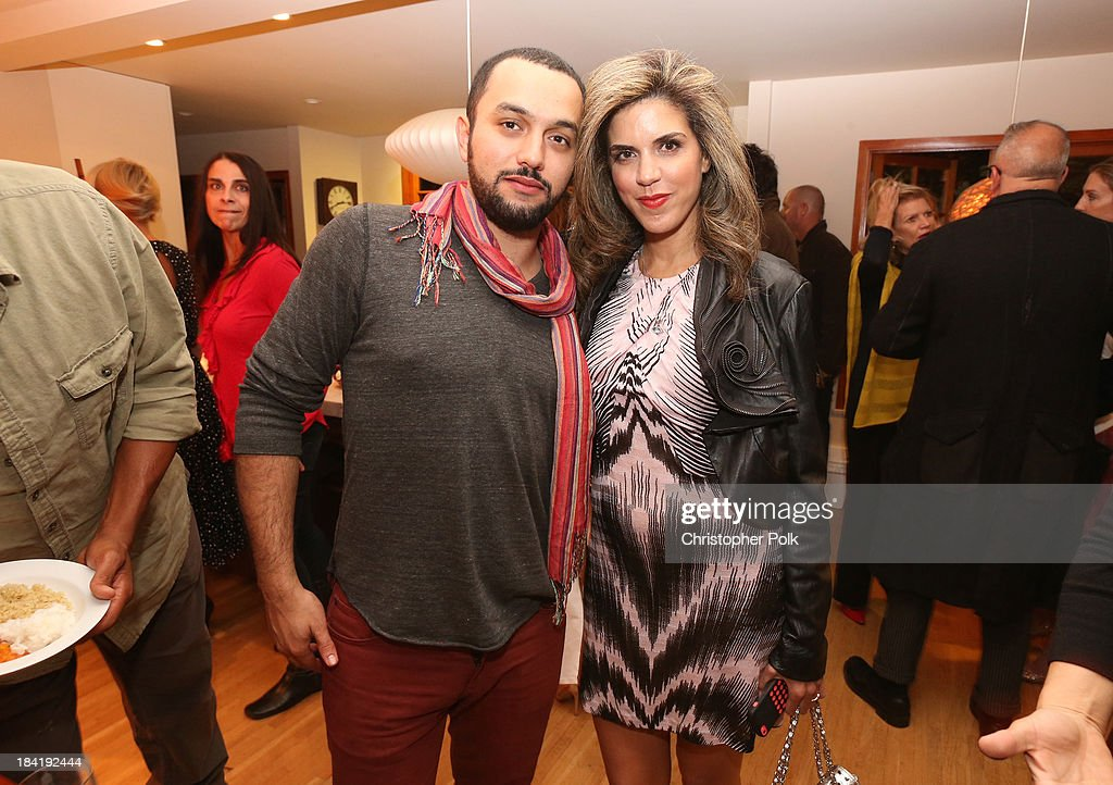 Filmmaker Karim Amer and Founder & CEO of Venus Media & PR Yasmine Shihata attend the screening for 'The Square' at the home of Maria Bello on October 11, 2013 in Santa Monica, California.