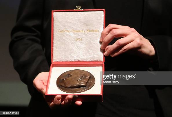 Filmmaker Laura Poitras holds her medal during an award ceremony for the Carl von Ossietzky journalism prize on December 14 2014 in Berlin Germany...