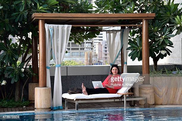 Filmmaker Leena Yadav catches a breath by the poolside at the Four Seasons Hotel on May 18 2015 in Mumbai India as she works on the postproduction of...