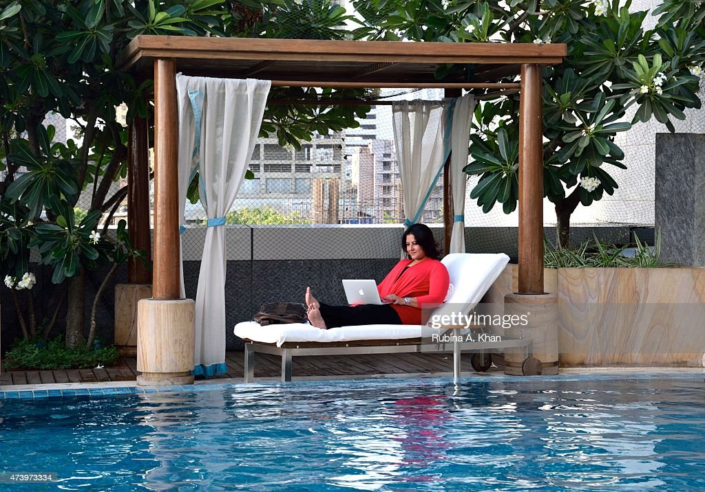 Filmmaker <a gi-track='captionPersonalityLinkClicked' href=/galleries/search?phrase=Leena+Yadav&family=editorial&specificpeople=6691560 ng-click='$event.stopPropagation()'>Leena Yadav</a> catches a breath by the poolside at the Four Seasons Hotel on May 18, 2015 in Mumbai, India, as she works on the post-production of her next film, Parched, written and directed by her and is jointly produced by her, husband Aseem Bajaj and Bollywood actor, Ajay Devgn, and shot by the acclaimed cinematographer, Russell Carpenter, that is due to release in the final quarter of 2015.
