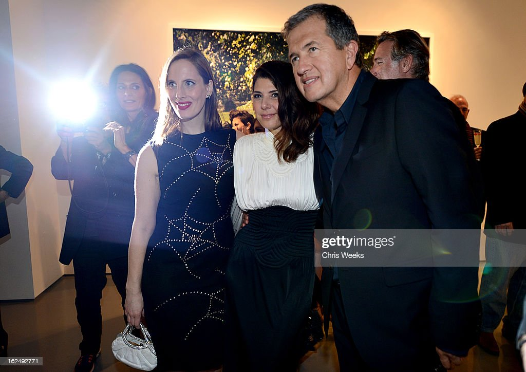 Filmmaker <a gi-track='captionPersonalityLinkClicked' href=/galleries/search?phrase=Liz+Goldwyn&family=editorial&specificpeople=542651 ng-click='$event.stopPropagation()'>Liz Goldwyn</a>, actress <a gi-track='captionPersonalityLinkClicked' href=/galleries/search?phrase=Marisa+Tomei&family=editorial&specificpeople=201516 ng-click='$event.stopPropagation()'>Marisa Tomei</a> and <a gi-track='captionPersonalityLinkClicked' href=/galleries/search?phrase=Mario+Testino&family=editorial&specificpeople=203087 ng-click='$event.stopPropagation()'>Mario Testino</a> attend a Private Reception For <a gi-track='captionPersonalityLinkClicked' href=/galleries/search?phrase=Mario+Testino&family=editorial&specificpeople=203087 ng-click='$event.stopPropagation()'>Mario Testino</a> at PRISM on February 23, 2013 in West Hollywood, California.
