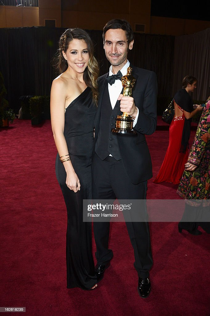Filmmaker Malik Bendjelloul (R), winner of the Best Documentary Feature award for 'Searching for Sugar Man,' and filmmaker Brittany Huckabee depart the Oscars at Hollywood & Highland Center on February 24, 2013 in Hollywood, California.