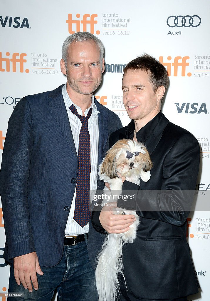 Filmmaker Martin McDonagh (L), actor Sam Rockwell (R) and Bonnie the Dog attend 'Seven Psychopaths' premiere during the 2012 Toronto International Film Festival at Ryerson Theatre on September 7, 2012 in Toronto, Canada.