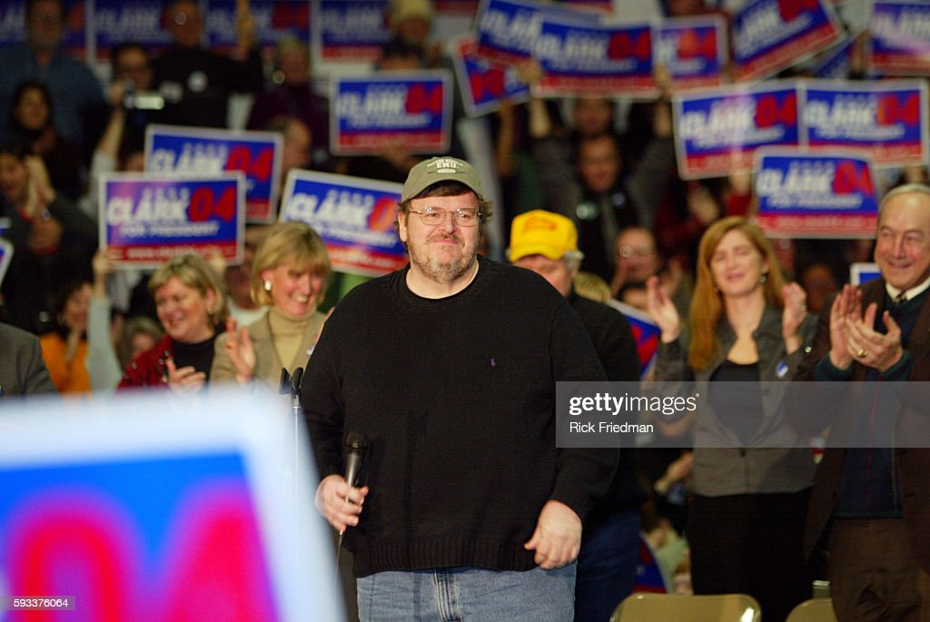 Filmmaker Michael Moore addresses the crowd of supporters of former General Wesley Clark at Pembroke Academy Moore endorsed Democratic presidential...