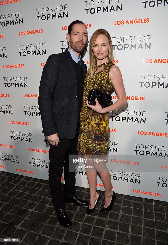 Filmmaker Michael Polish (L) and actress Kate Bosworth arrive wearing Topshop at the Topshop Topman LA Opening Party at Cecconi's West Hollywood on February 13, 2013 in Los Angeles, California.