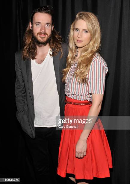 Filmmaker Mike Cahill and actress/writer Brit Marling pose for pictures at the Apple Store Soho on July 21 2011 in New York City