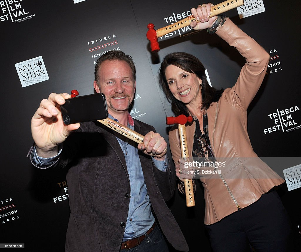 Filmmaker Morgan Spurlock and Beth Comstock attend the Tribeca Disruptive Innovation Awards during the 2013 Tribeca Film Festival at NYU Paulson Auditorium on April 26, 2013 in New York City.