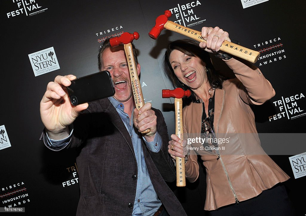 Filmmaker <a gi-track='captionPersonalityLinkClicked' href=/galleries/search?phrase=Morgan+Spurlock&family=editorial&specificpeople=212719 ng-click='$event.stopPropagation()'>Morgan Spurlock</a> and Beth Comstock attend the Tribeca Disruptive Innovation Awards during the 2013 Tribeca Film Festival at NYU Paulson Auditorium on April 26, 2013 in New York City.