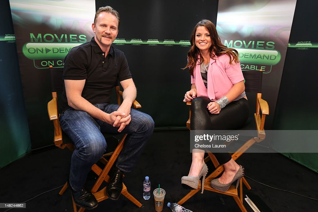 Filmmaker <a gi-track='captionPersonalityLinkClicked' href=/galleries/search?phrase=Morgan+Spurlock&family=editorial&specificpeople=212719 ng-click='$event.stopPropagation()'>Morgan Spurlock</a> (L) and Movies On Demand host Camille Ford speak at the Movies On Demand lounge at Comic Con at Hard Rock Hotel San Diego on July 12, 2012 in San Diego, California.