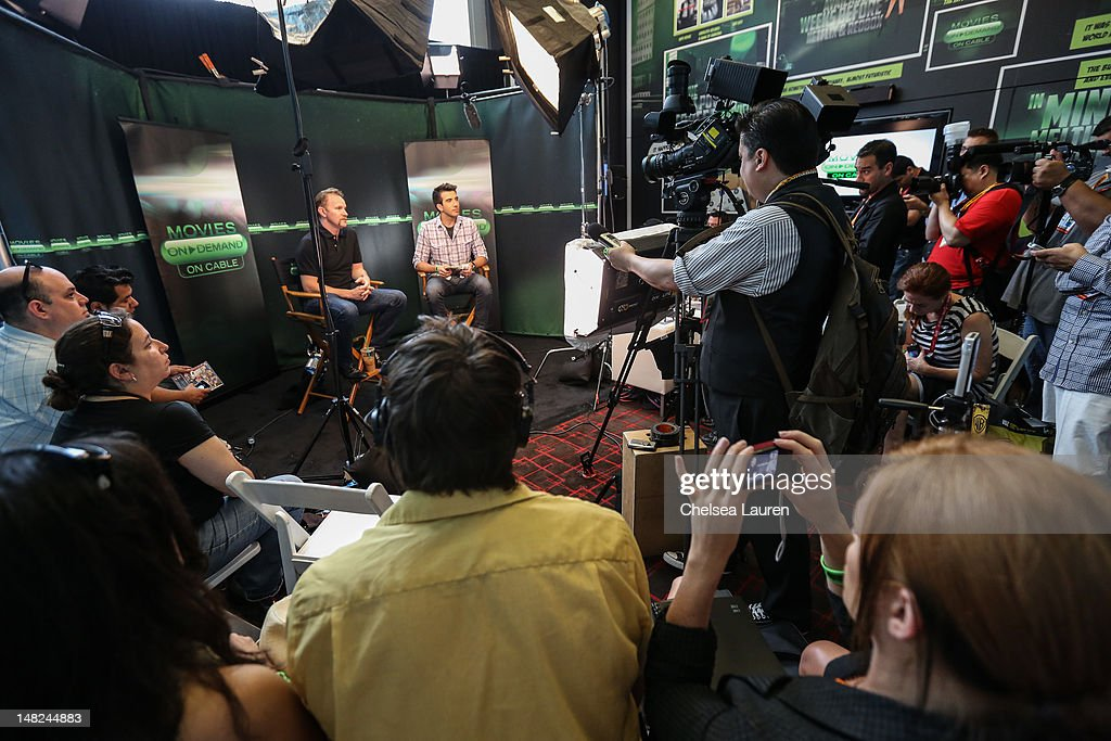 Filmmaker Morgan Spurlock (L) and ReelzChannel host Jeremy Parsons speak at the Movies On Demand lounge at Comic Con at Hard Rock Hotel San Diego on July 12, 2012 in San Diego, California.