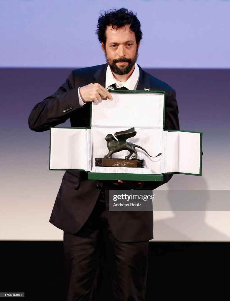 Filmmaker Noaz Deshe poses on stage with the Lion of the Future Award he received for his movie 'White Shadow' during the Closing Ceremony during the 70th Venice International Film Festival at the Palazzo del Cinema on September 7, 2013 in Venice, Italy.