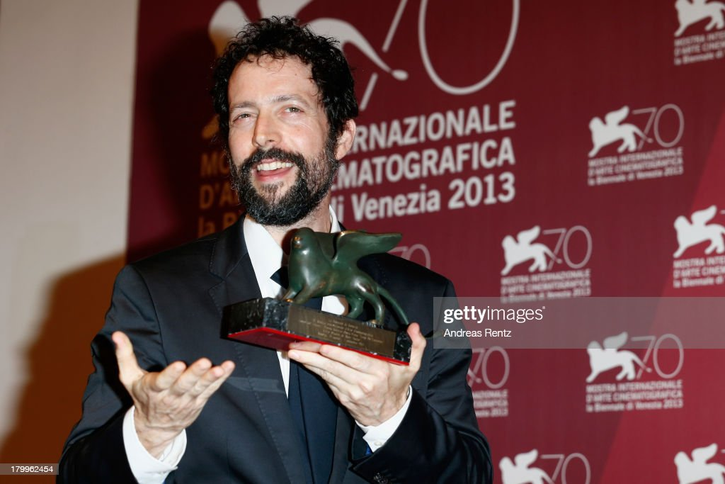 Filmmaker Noaz Deshe poses with the Lion of the Future Award he received for his movie 'White Shadow' as he attends the Award Winners Photocall during the 70th Venice International Film Festival at Palazzo del Casino on September 7, 2013 in Venice, Italy.