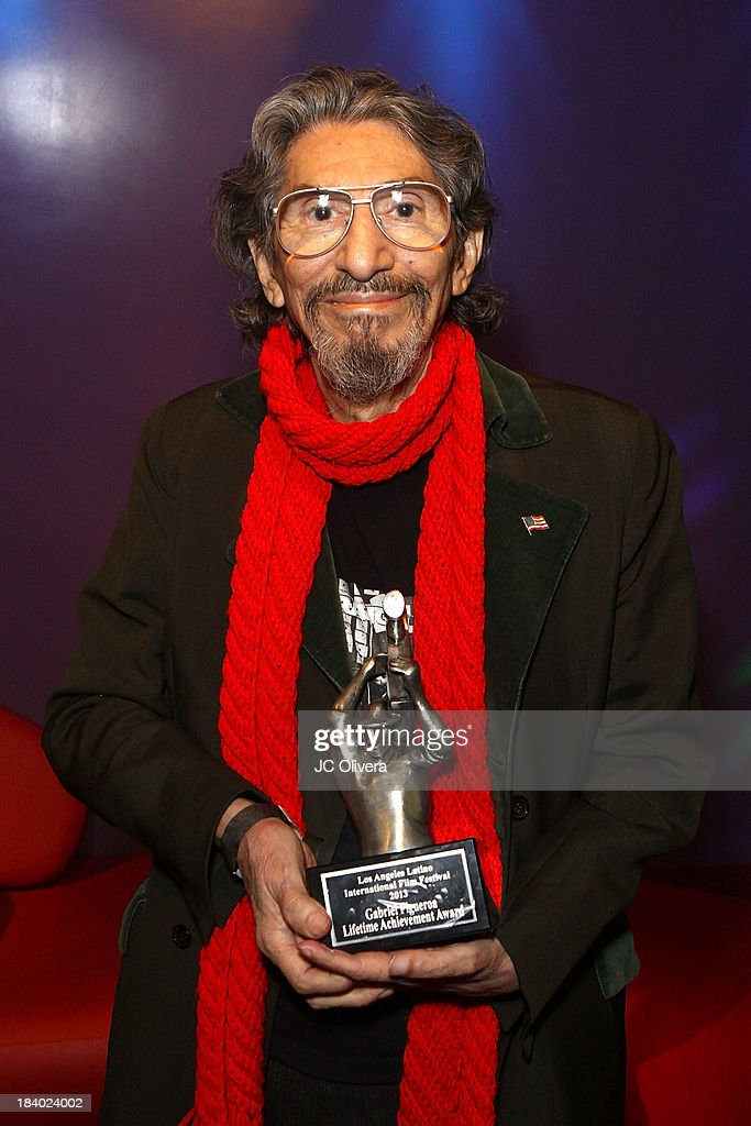 Filmmaker Pablo Ferro poses with his Gabi Lifetime Achievement Award during The 2013 Los Angeles Latino International Film Festival - Opening Night Gala Premiere of 'Pablo' at the El Capitan Theatre on October 10, 2013 in Hollywood, California.