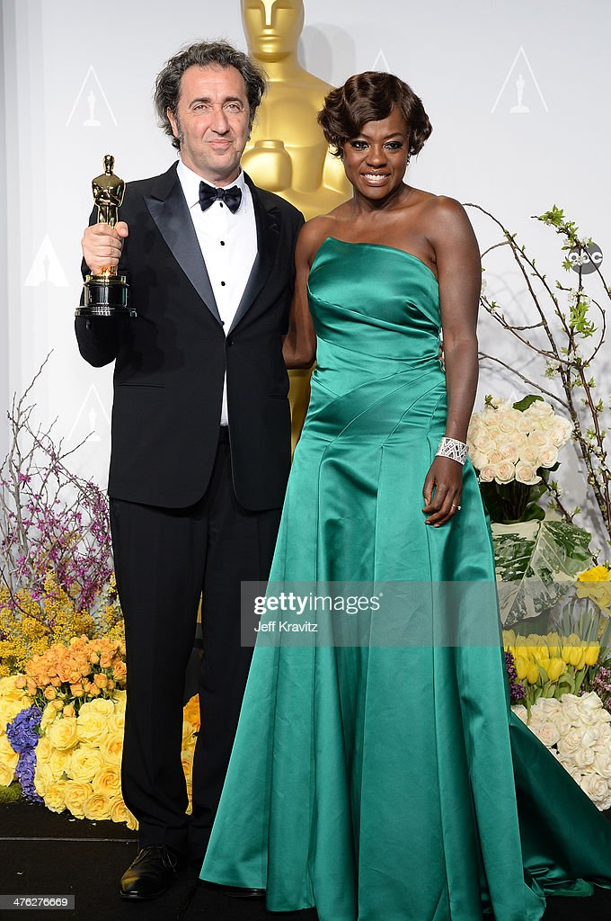 Filmmaker Paolo Sorrentino and actress Viola Davis pose in the press room during the Oscars at Loews Hollywood Hotel on March 2 2014 in Hollywood...