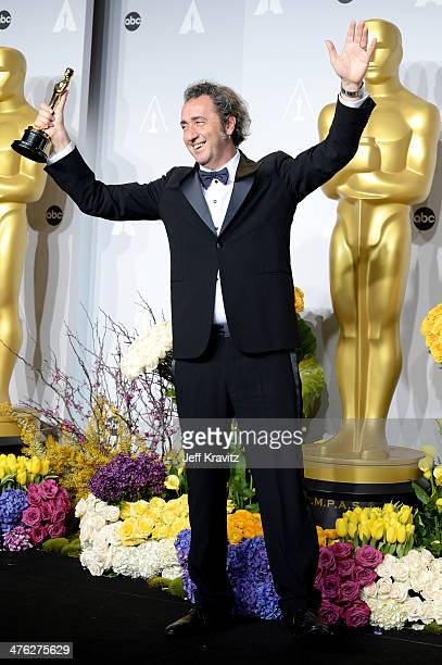 Filmmaker Paolo Sorrentino poses in the press room during the Oscars at Loews Hollywood Hotel on March 2 2014 in Hollywood California