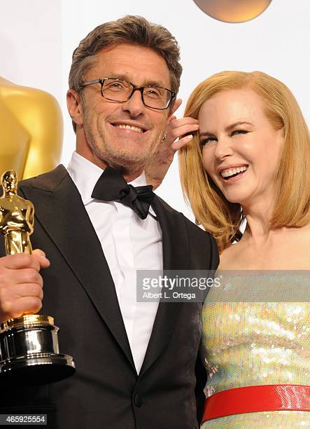 Filmmaker Pawel Pawlikowski winner of the Best Foreign Language Film Award for 'Ida' and actress Nicole Kidman poses inside the press room of the...