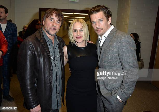 Filmmaker Richard Linklater and actors Patricia Arquette and Ethan Hawke attend the 'Boyhood' premiere at Eccles Center Theatre during the 2014...