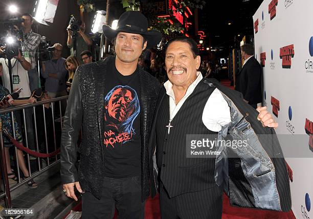 Filmmaker Robert Rodriguez and actor Danny Trejo arrive at the premiere of Open Road Films' 'Machete Kills' at Regal Cinemas LA Live on October 2...
