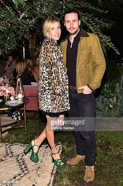 Filmmaker Sam TaylorJohnson and actor Aaron Taylor Johnson attend Barneys New York Jennifer Aniston and Tobey Maguire host a private dinner to...