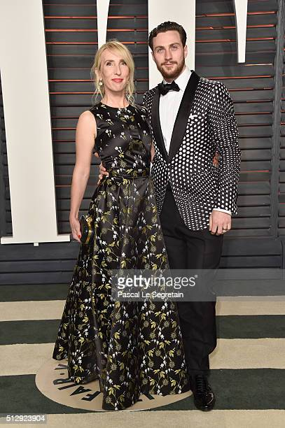Filmmaker Sam TaylorJohnson and actor Aaron TaylorJohnson attend the 2016 Vanity Fair Oscar Party Hosted By Graydon Carter at the Wallis Annenberg...