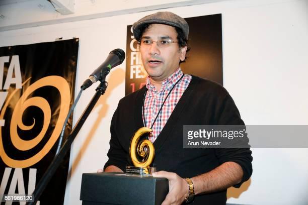 Filmmaker Shankey Srinivasan receives a festival award for his film The Last Smile at the Santa Cruz Film Festival at Tannery Arts Center on October...