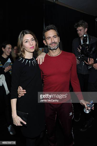 Filmmaker Sofia Coppola and designer Marc Jacobs pose backstage at the Marc Jacobs fashion show during MercedesBenz Fashion Week Fall 2014 at...