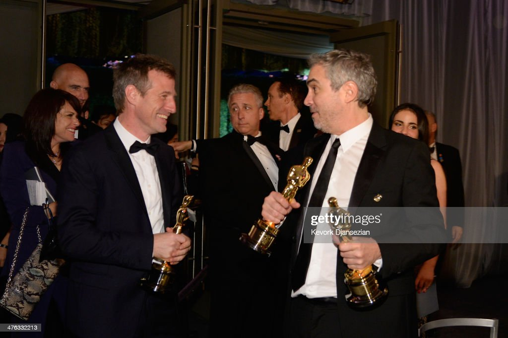 Filmmaker <a gi-track='captionPersonalityLinkClicked' href=/galleries/search?phrase=Spike+Jonze&family=editorial&specificpeople=2619298 ng-click='$event.stopPropagation()'>Spike Jonze</a> and director <a gi-track='captionPersonalityLinkClicked' href=/galleries/search?phrase=Alfonso+Cuaron&family=editorial&specificpeople=213792 ng-click='$event.stopPropagation()'>Alfonso Cuaron</a> attend the Oscars Governors Ball at Hollywood & Highland Center on March 2, 2014 in Hollywood, California.