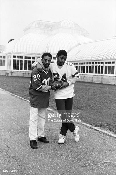 Filmmaker Spike Lee and jazz saxophonist composer and bandleader Branford Marsalis pose for a portrait on November 17 1982 at the Brooklyn Botanical...