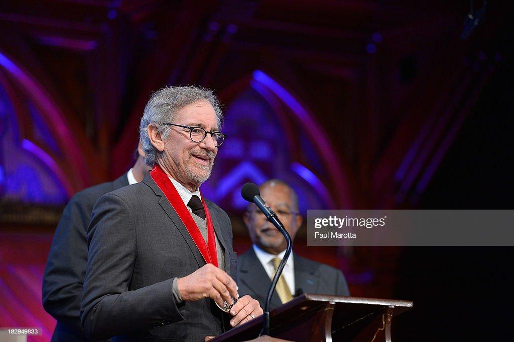 Filmmaker Steven Spielberg receives the 2013 W.E.B. Du Bois Medal at a ceremony at Harvard University's Sanders Theatre on October 2, 2013 in Cambridge, Massachusetts.