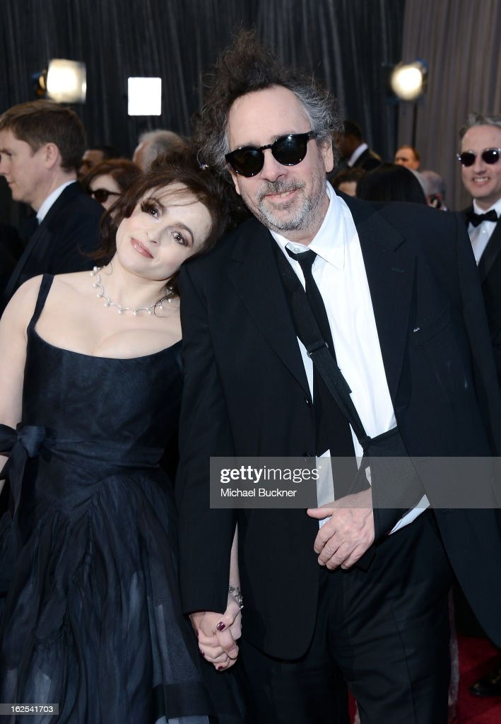 Filmmaker Tim Burton and actress Helena Bonham Carter arrive at the Oscars at Hollywood Highland Center on February 24 2013 in Hollywood California