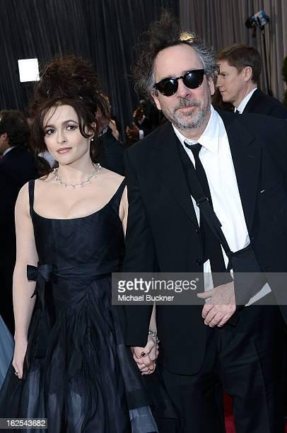 Filmmaker Tim Burton and actress Helena Bonham Carter arrive at the Oscars at Hollywood Highland Center on February 24 2013 in Hollywood California