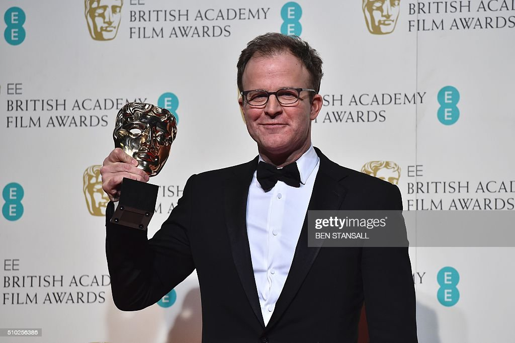 US filmmaker Tom McCarthy poses with the award for an original screenplay for the film 'Spotlight' at the BAFTA British Academy Film Awards at the Royal Opera House in London on February 14, 2016. AFP / BEN STANSALL / AFP / BEN STANSALL