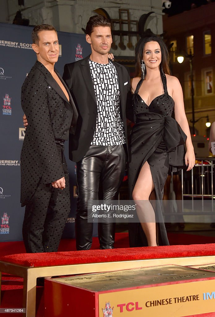 Filmmaker Vlad Yudin (C) poses with designer Jeremy Scott (L) and singer Katy Perry (R) during their hand print ceremony at TCL Chinese Theatre IMAX Forecourt on September 8, 2015 in Hollywood, California.