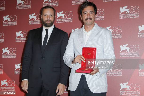 Filmmaker Yorgos Lanthimos and writer Efthymis Filippou of 'Alps' pose with the Best Screenplay Award during the Award Winners Photocall during the...