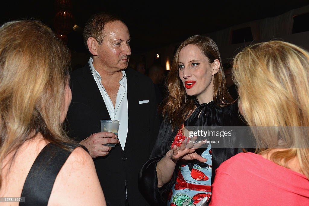 Filmmaker/artist Liz Goldwyn (R) and Group President, The Estee Lauder Companies Inc John Demsey attend the amfAR Inspiration Miami Beach Party at Soho Beach House on December 6, 2012 in Miami Beach, Florida.